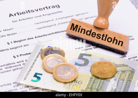 minimum wages in Germany with 8,50 Euros and employment contract - Stock Photo