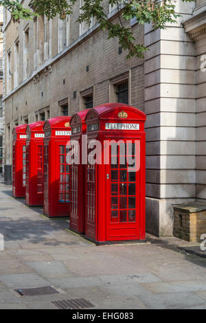 Traditional red K2 telephone kiosks in a row near Covent Garden in central London, England. - Stock Photo