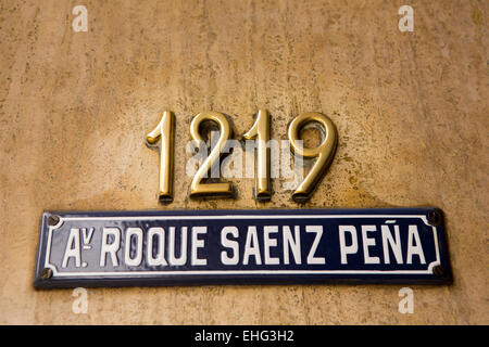 Argentina, Buenos Aires, 1219 Avenida Presidente Roque Sáenz Pena, house number and blue enameled road name sign - Stock Photo