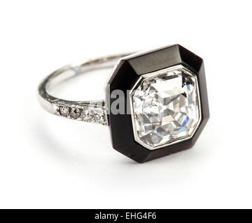 Art deco Asscher cut diamond and onyx ring. - Stock Photo