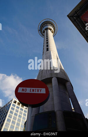 The Sky Tower towers above other buildings in Auckland's central business district, Northland, New Zealand - Stock Photo