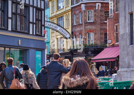 Crowds heading into Carnaby Street, London, England. - Stock Photo