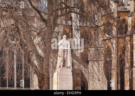 Statue of King George V outside Westminster Abbey, London, England. - Stock Photo