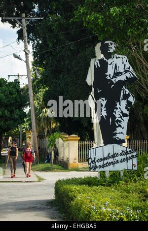 Cuba Santa Clara street scene large billboard of Che Guevara close to railway track he bulldozed in Revolution vs - Stock Photo