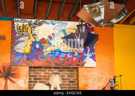 Cuba Santa Clara nightclub bar cafe cafeteria restaurante restaurant local art work painting umbrella umbrellas - Stock Photo
