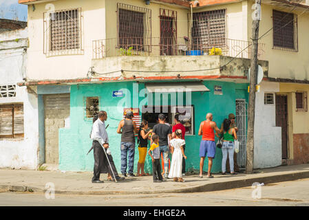 Cuba Santa Clara corner cafe cafeteria snack sandwich bar fast food counter house front room customers eaters diners - Stock Photo