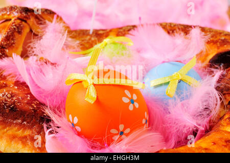 closeup of a traditional mona de pascua typical in Spain, a cake with boiled eggs eaten on Easter Monday, with some - Stock Photo