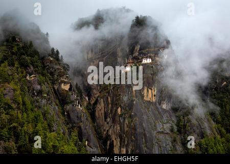 BU00325-00...BHUTAN - Taktshang Goemba, (the Tiger's Nest Monastery), viewed on a foggy morning from the tea house. - Stock Photo