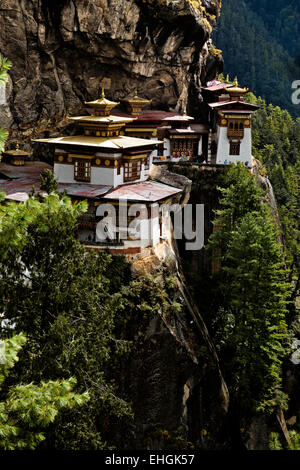 BHUTAN - Taktshang Goemba, (the Tiger's Nest Monastery), perched on the side of a cliff high above the Paro River - Stock Photo