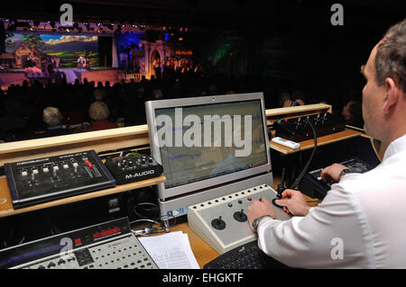 A special effects technician adds to the action during a live stage performance - Stock Photo