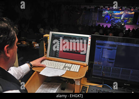 A sound technician adds to the action during a live stage performance - Stock Photo