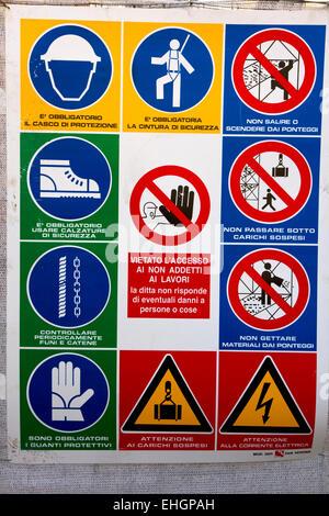 Safety notice on Italian building site. Pisa, Italy - Stock Photo
