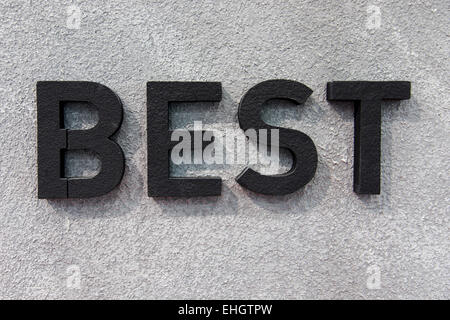 Best concept background, three dimensional black best text on the wall - Stock Photo