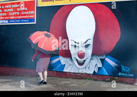 Imposing clown face mural on the side of a joke shop in Blackpool town centre, Lancashire, UK - Stock Photo