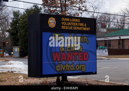 Fire fighters and EMT wanted sign in front of station - Virginia USA - Stock Photo
