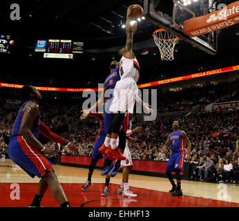 March 13, 2015 - DAMIAN LILLARD (0) drives in the lane for a dunk but is fouled. The Portland Trail Blazers play - Stock Photo
