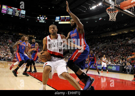 March 13, 2015 - NICOLAS BATUM (88) drives to the basket against ANDRE DRUMMOND (0). The Portland Trail Blazers - Stock Photo