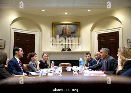 US President Barack Obama meets with Housing and Urban Development Secretary Julian Castro in the Roosevelt Room - Stock Photo