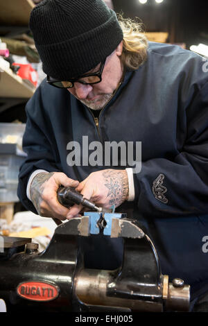Mechanic, engineer, TV celebrity and gun maker Jesse James at work in his workshop near Dripping Springs, Texas, - Stock Photo