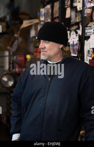 Mechanic, engineer, TV celebrity and gun maker Jesse James at his workshop near Dripping Springs, Texas, USA - Stock Photo
