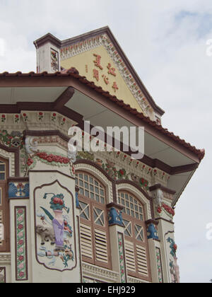 Lorong Bachok shophouse and cultural association with classic Chinese tales depicted beneath the windows in Singapore - Stock Photo