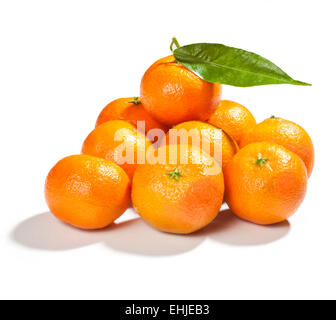 fresh mandarins with leaf isolated on white background - Stock Photo