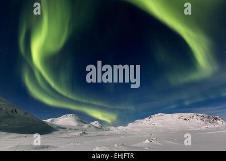 Northern lights at Singistugorna huts, Kebnekaise mountain area, Kiruna, Sweden, Europe, EU - Stock Photo
