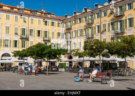 NICE, FRANCE - OCTOBER 2, 2014: Restaurant patios at Place Garibaldi, one of the oldest and largest squares in the - Stock Photo