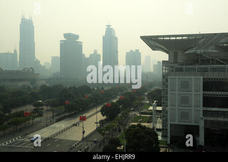 The view of People's Square in a smoggy day with Shanghai Urban Planning Exhibition Center in foreground. Shanghai, - Stock Photo