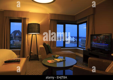 Guest room with the view of Sydney Harbour Bridge and Sydney Opera House in Four Seasons Hotel, Sydney Australia - Stock Photo