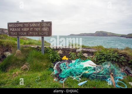 sandy bay litter sign with litter castlehaven west cork ireland - Stock Photo