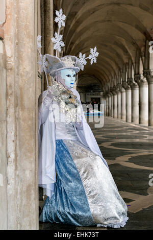 Venice carnival participant in gallery of Doge's Palace, Venice - Stock Photo