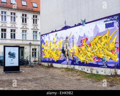 Berlin 'Pied Piper of Hamelin' street art mural and Converse Trainers Advertisement, Chucks shoes 'made for you' - Stock Photo