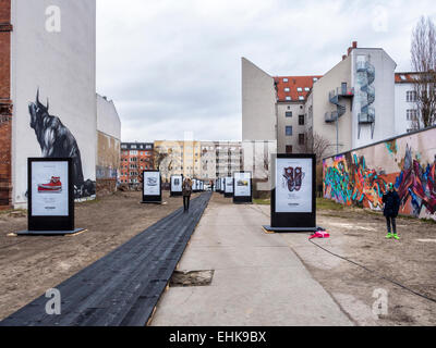 Berlin Converse Trainers Advertisement, Chucks shoes 'made for you' campaign catwalk and street art murals - Stock Photo