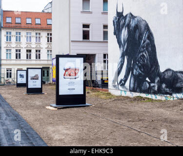 Berlin Converse Trainers Advertisement, Chucks shoes 'made for you' campaign and street art mural, Minotaur arising - Stock Photo