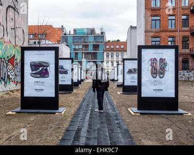 Berlin Converse Trainers Advertisement, Chucks shoes 'made for you' campaign, senior man walking on catwalk - Stock Photo