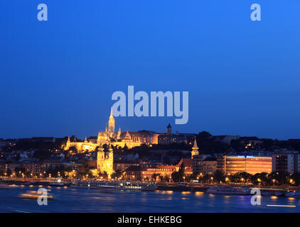 The twin towers of the Church of St Anne and the spire of Matyas Church, Budapest, seen from the River Danube at - Stock Photo