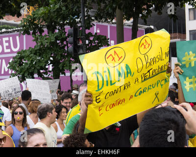 A protester carries a hand-written placard 'Dilm, Brazil is not against Petrobras, we are against corruption'. Rio - Stock Photo