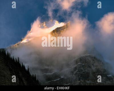Early morning sunrise on peaks around Moraine Lake. Banff National Park. Alberta Canada. - Stock Photo