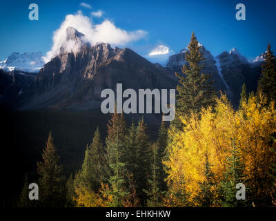 Early morning sunrise on peaks around Moraine Lake with fall color. Banff National Park. Alberta Canada. - Stock Photo