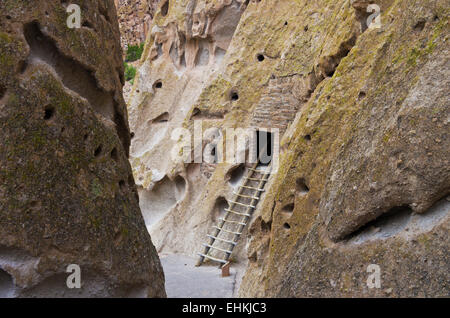 Bandelier National Monument, New Mexico, United States.  Ladder going to room built into cliff wall. - Stock Photo