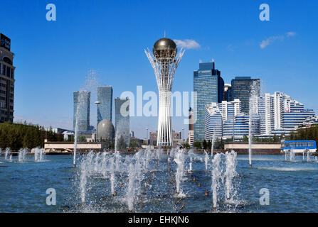ASTANA, KAZAKHSTAN - MAY 10, 2014: Bayterek is a monument and observation tower in Astana. The height of buildings - Stock Photo