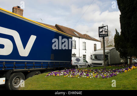 large lorries and van winding there way through narrow road around Rogate church on the A272 near Midhurst, Sussex, - Stock Photo