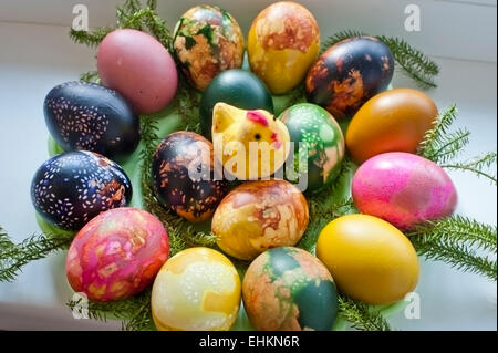 Easter eggs or Paschal eggs, hand decorated by boiling in dye, with onion skins and linseed. - Stock Photo
