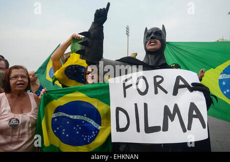 Rio De Janeiro, Brazil. 15th Mar, 2015. A demonstrator holds a sign with slogans during a protest against the government - Stock Photo