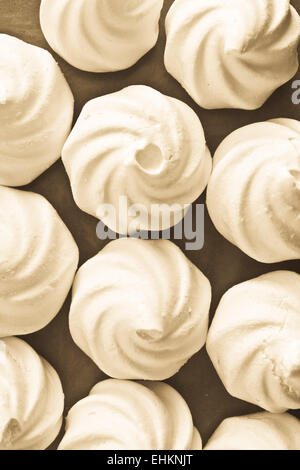 Selection of white meringue nests in sepia tones - Stock Photo