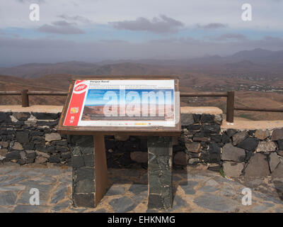 Parque Rural information board at viewpoint overlooking protected area in Fuerteventura Canary Islands Spain - Stock Photo