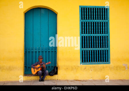 A man plays guitar in Trinidad, Cuba - Stock Photo