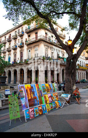 Colourful paintings in front of the buildings they represent, Havana, Cuba - Stock Photo