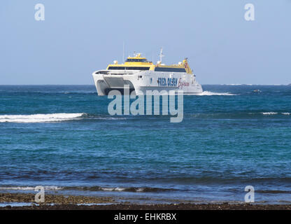 Catamaran car and passenger ferry, Fred Olsen Express busy in the canary islands, here between Fuerteventura and - Stock Photo